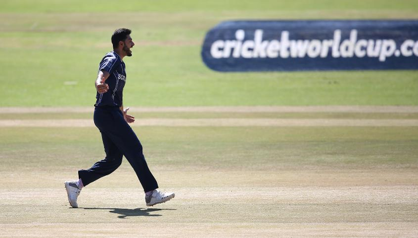 Safyaan Sharif of Scotland celebrates the wicket of Shai Hope of The Windies during The ICC Cricket World Cup Qualifier between The Windies and Scotland at The Harare Sports Club on March 21, 2018 in Harare, Zimbabwe (©ICC).