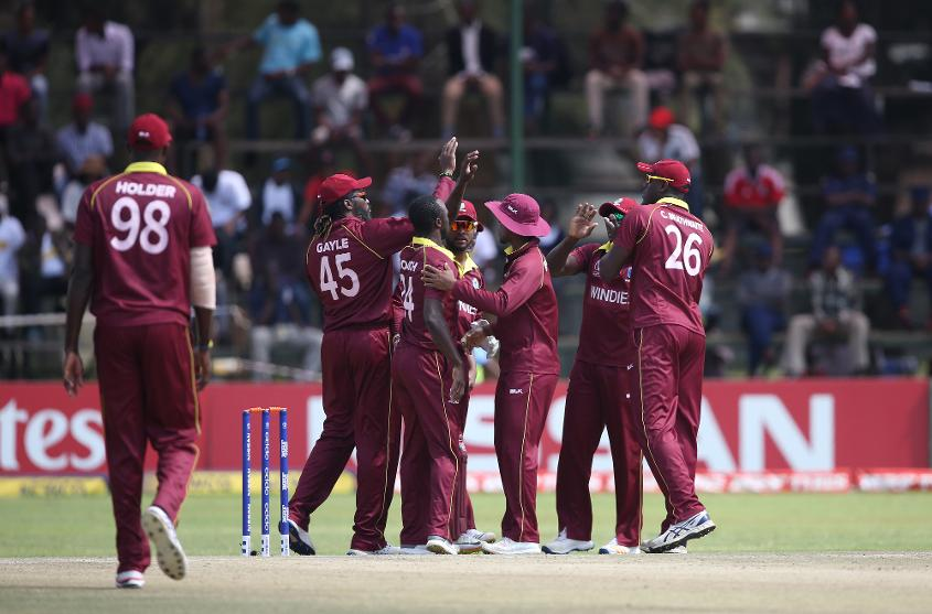 Windies players celebrate the wicket of Michael Jones of Scotland during The ICC Cricket World Cup Qualifier between The Windies and Scotland at The Harare Sports Club on March 21, 2018 in Harare, Zimbabwe (©ICC).