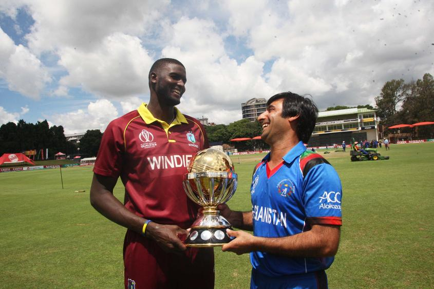 Jason Holder and Asghar Stanikzai with ICC Cricket World Cup Qualifier 2018 trophy
