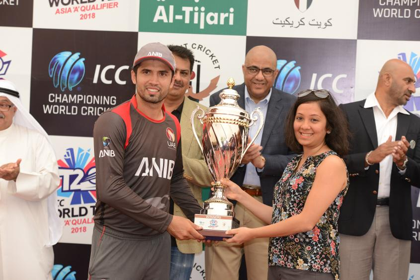 UAE captain Rohan Mustafa receives the tournament trophy