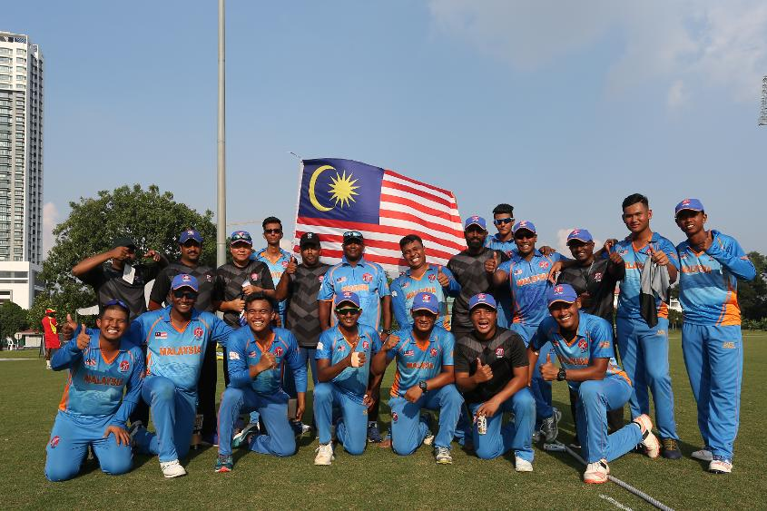 Malaysia team celebrates after winning their opening encounter against Uganda