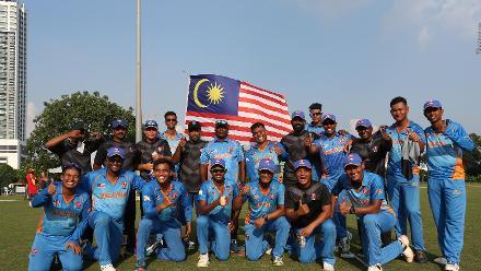 Malaysia team celebrates after winning their opening encounter against Uganda