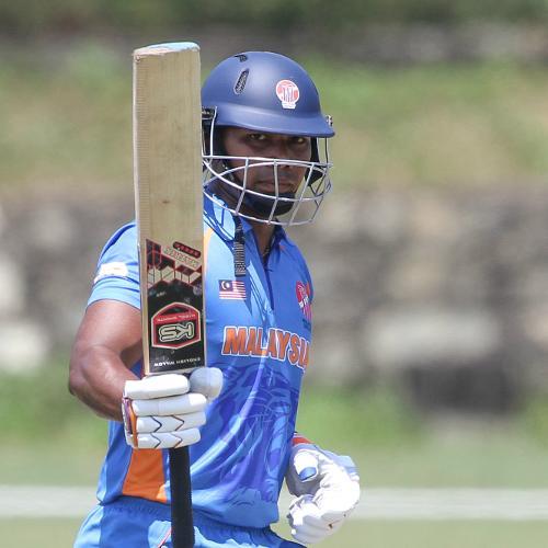 Suhan Kumar raises the bat after scoring his half-century