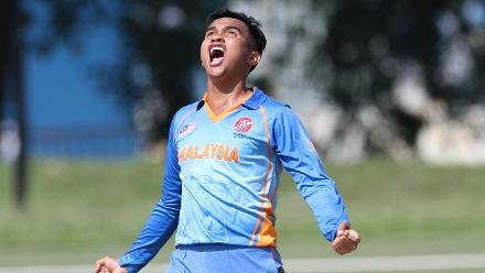 Muhamad Syahadat of Malaysia celebrates after picking up a wicket