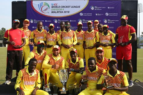 Uganda players pose with the winner's trophy