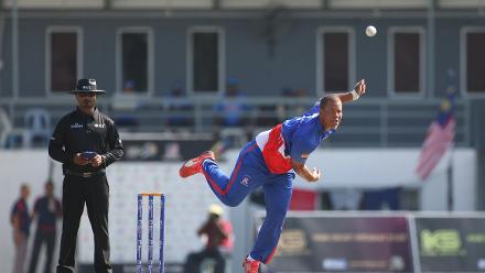 Kwasi James of Bermuda bowls during the match against Malaysia