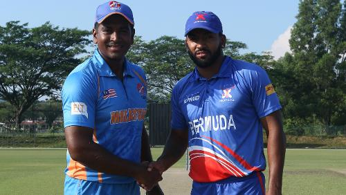 Malaysia and Bermuda captains shake hands before the crucial encounter