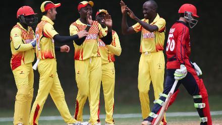 Uganda team celebrate after dismissing Jake Dunford