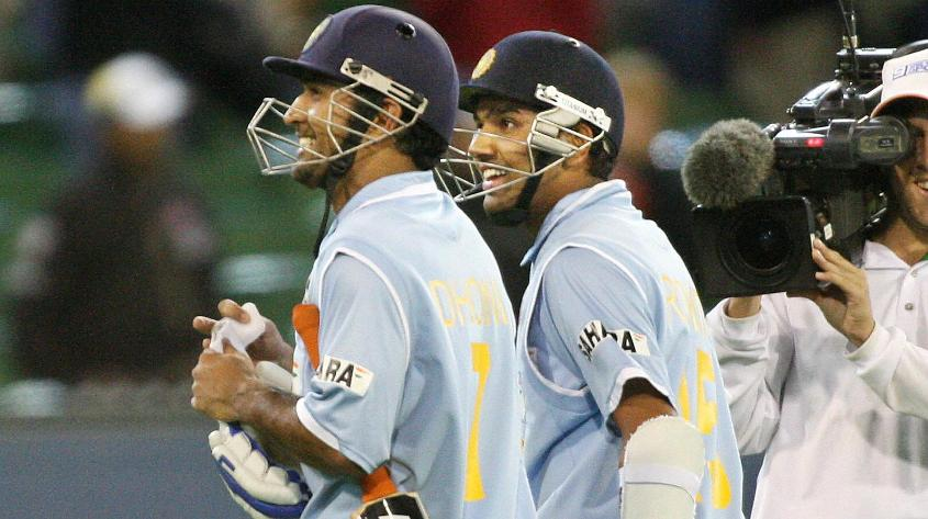MS Dhoni and Rohit Sharma walk off the ground after completing a five-wicket victory