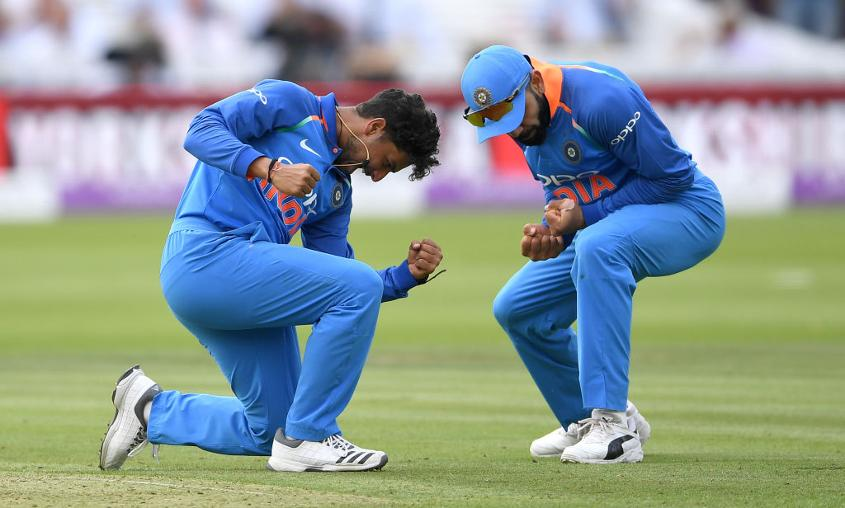 Kuldeep Yadav celebrates with Virat Kohli after dismissing Eoin Morgan in the 2nd ODI between England and India