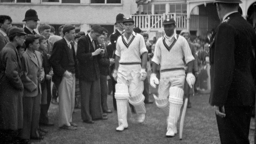 Weekes walks out to bat with Bruce Pairaudeau during the Windies' tour game against Hampshire in 1957