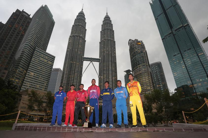 Team Captains with the trophy at the Petronas Twin Tower at the background