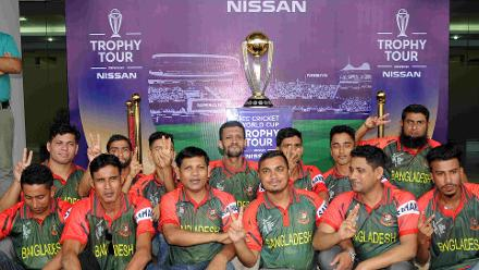 Fans of the Bangladesh team pose with the trophy