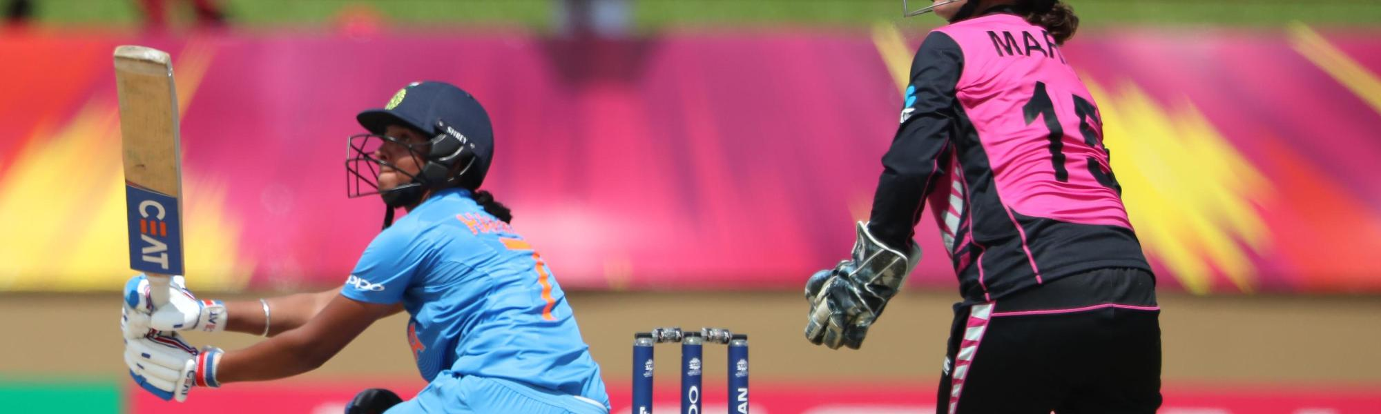 Harmanpreet Kaur of India sweeps as Katey Martin of New Zealand looks on during match 1 of the ICC Women's World T20 match between New Zealand v India on November 9, 2018 at the National Stadium in Providence, Guyana.