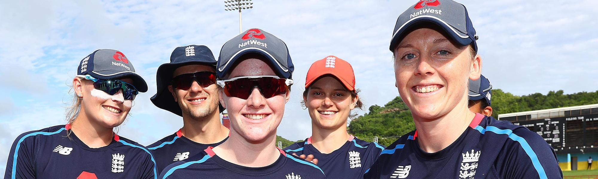 Heather Knight of England presents Kirstie Gordon of England with her first cap during the ICC Women's World T20 2018 match between England and Bangladesh at Darren Sammy Cricket Ground on November 12, 2018 in Gros Islet, Saint Lucia.