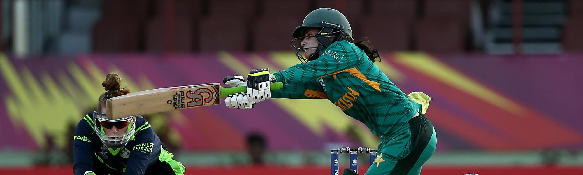 Javeria Khan of Pakistan bats with Mary Waldron, wicket keeper of Ireland looking on during the ICC Women's World T20 2018 match between Pakistan and Ireland at Guyana National Stadium on November 13, 2018 in Providence, Guyana.