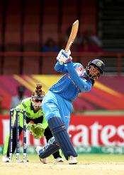Smriti Mandhana of India bats with Mary Waldron wicket keeper of Ireland looking on during the ICC Women's World T20 2018 match between India and Ireland at Guyana National Stadium on November 15, 2018 in Providence, Guyana.