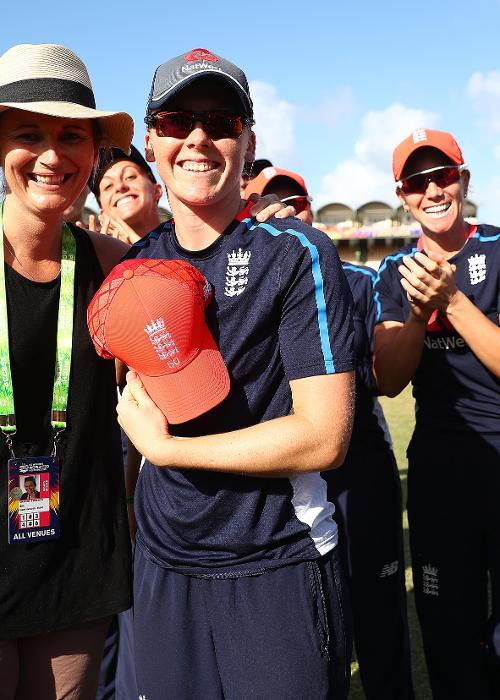 Heather Knight of England is presented with her 50th cap from former England captain Charlotte Edwards during the ICC Women's World T20 2018 match between England and South Africa at Darren Sammy Cricket Ground on November 16, 2018 in Gros Islet.
