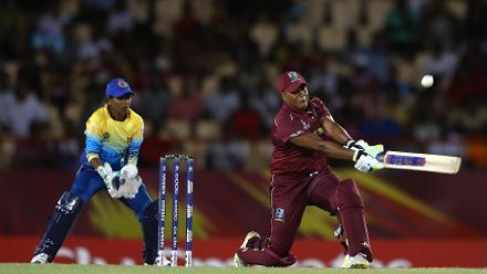 Natasha McLean of Windies hits the ball towards the boundary, as dilani Manodara of Sri Lanka looks on during the ICC Women's World T20 2018 match between Windies and Sri Lanka at Darren Sammy Cricket Ground on November 16, 2018.