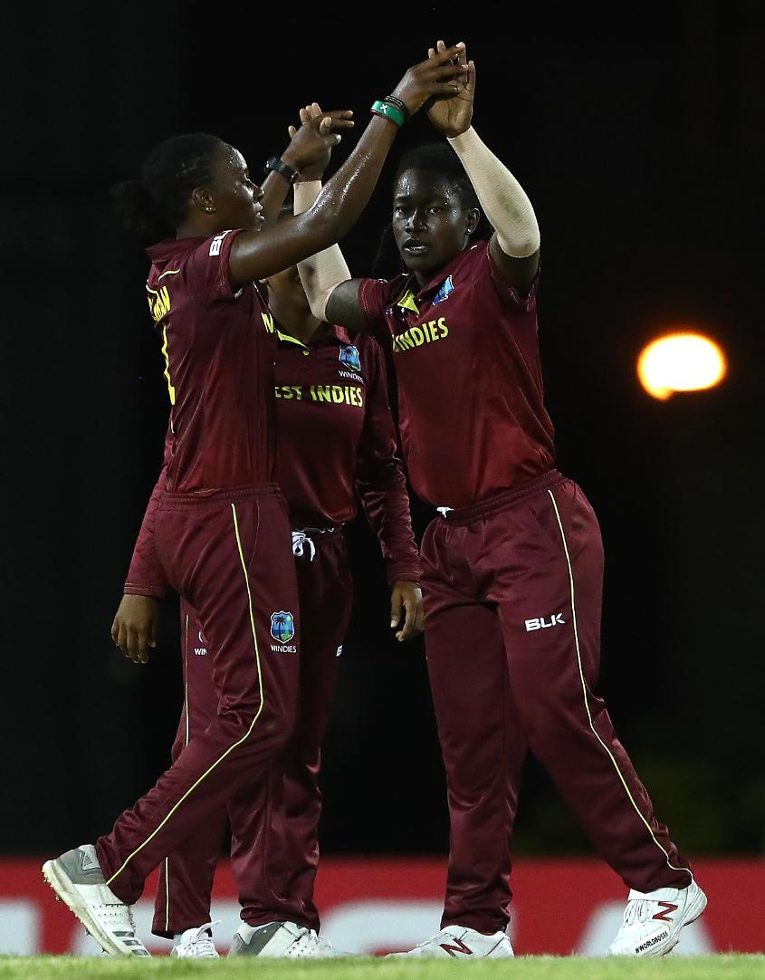 Deandra Dottin of Windies is congratulated on bowling Eshani Lokusuriyage of Sri Lanka during the ICC Women's World T20 2018 match between Windies and Sri Lanka at Darren Sammy Cricket Ground on November 16, 2018 in Gros Islet, Saint Lucia.