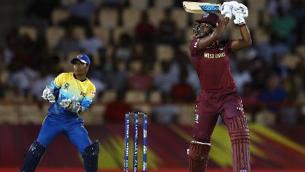 Hayley Matthews of Windies hits the ball towards the boundary, as Dilani Manodara of Sri Lanka looks on during the ICC Women's World T20 2018 match between Windies and Sri Lanka at Darren Sammy Cricket Ground on November 16, 2018.