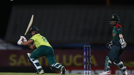 Dane van Niekerk of South Africa hots the ball towards the boundary, as Nigar Sultana of Bangladesh looks on during the ICC Women's World T20 2018 match between South Africa and Bangladesh at Darren Sammy Cricket Ground on November 18, 2018.