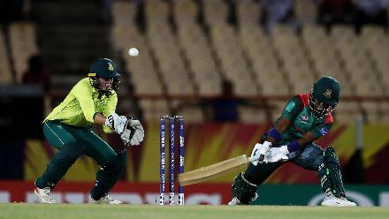 Rumana Ahmed of Bangladesh plays a reverse sweep, as Faye Tunnicliffe of South Africa looks on during the ICC Women's World T20 2018 match between South Africa and Bangladesh at Darren Sammy Cricket Ground on November 18, 2018.