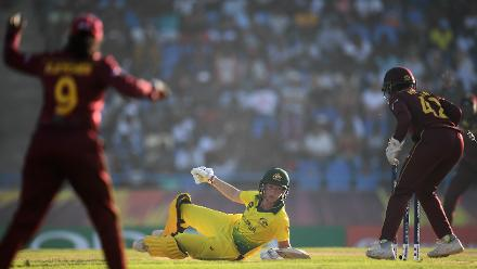 Meg Lanning of Australia dives to make her ground during the ICC Women's World T20 2018 Semi-Final match between Windies and Australia at Sir Viv Richards Cricket Ground on November 22, 2018 in Antigua, Antigua and Barbuda.