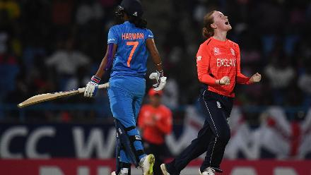 Kirstie Gordon of England celebrates after dismissing Harmanpreet Kaur of India(L) during the ICC Women's World T20 2018 Semi-Final match between England and India at Sir Viv Richards Cricket Ground on November 22, 2018 in Antigua, Antigua and Barbuda.