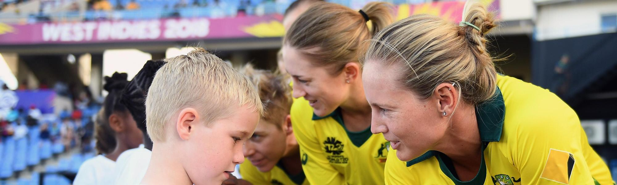 Meg Lanning of Australia shakes hands with a young mascot during the ICC Women's World T20 2018 Semi-Final match between Windies and Australia at Sir Viv Richards Cricket Ground on November 22, 2018 in Antigua, Antigua and Barbuda.
