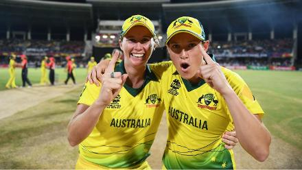 Australia's players react in the immediate aftermath to their WT20 title win