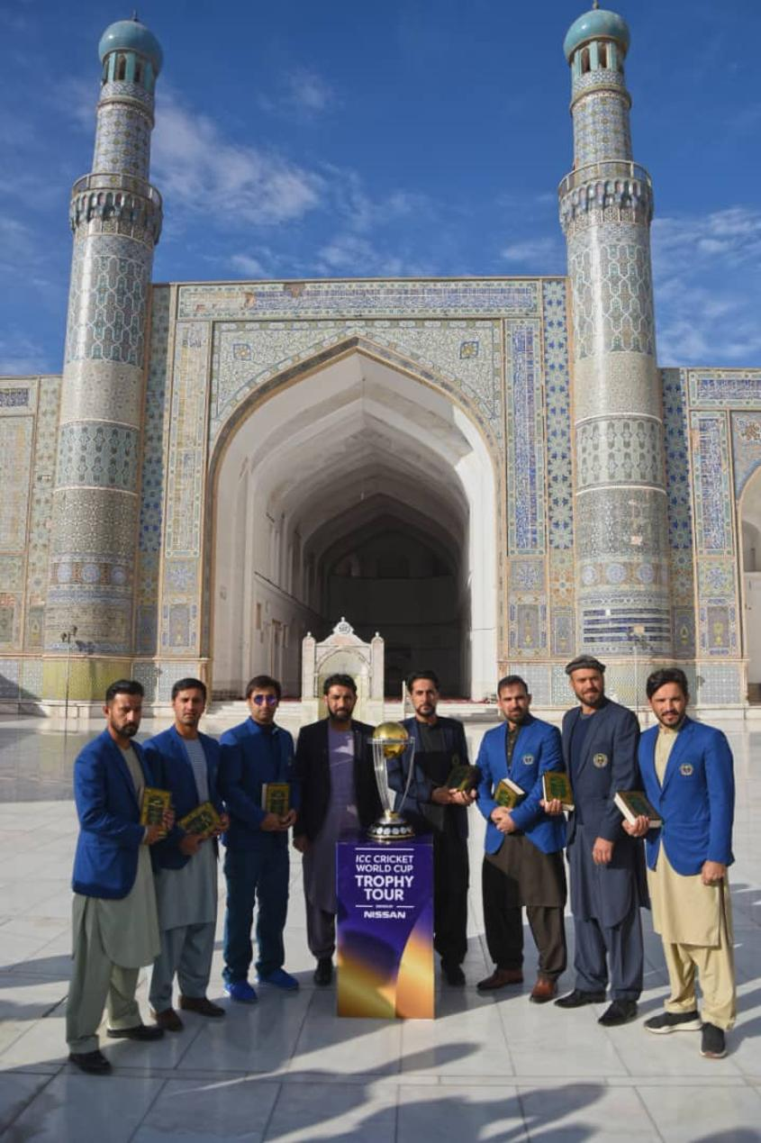 Players posing outside the great mosque of Herat