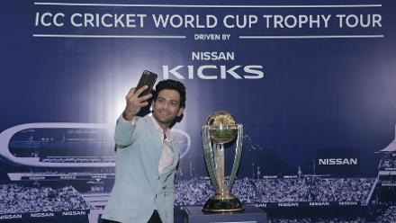 Unmukt Chands takes a selfie with the prized silverware during the ICC CWC Trophy Tour driven by Nissan Kicks