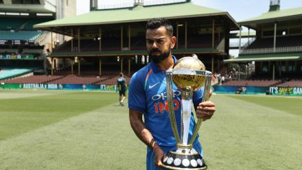 Virat Kohli poses with the ICC Cricket World Cup trophy