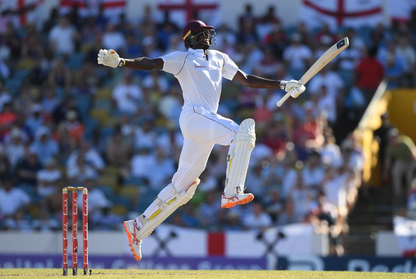 Jason Holder celebrates after reaching his maiden Test double hundred