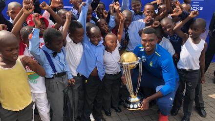 Lungi Ngidi poses with young cricket fans during the ICC Cricket World Cup Trophy Tour, driven by Nissan