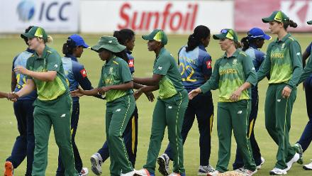 Players shake hands after the end of the match; South Africa Women won by seven runs