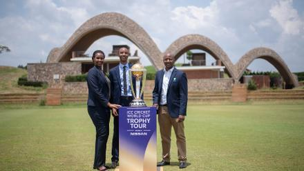 Sonia Uwimana, Audifax Byiringiro and Eddy Baraba from Rwanda Cricket with the Cricket World Cup Trophy