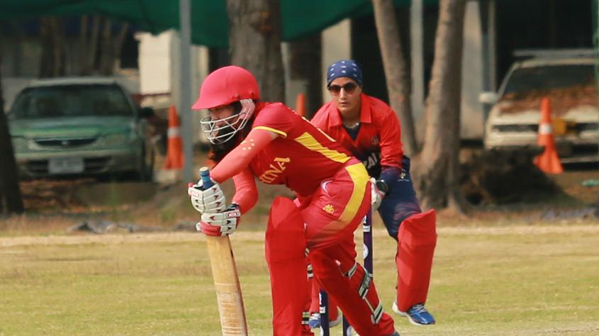 A China batter defends one into the off-side