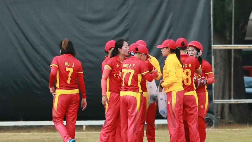 China celebrate a wicket against Kuwait