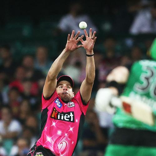 Winner - Phil Hillyard: Sydeny Sixers' Moises Henriques grabs a stunner to send back Nick Larkin of Melbourne Stars
