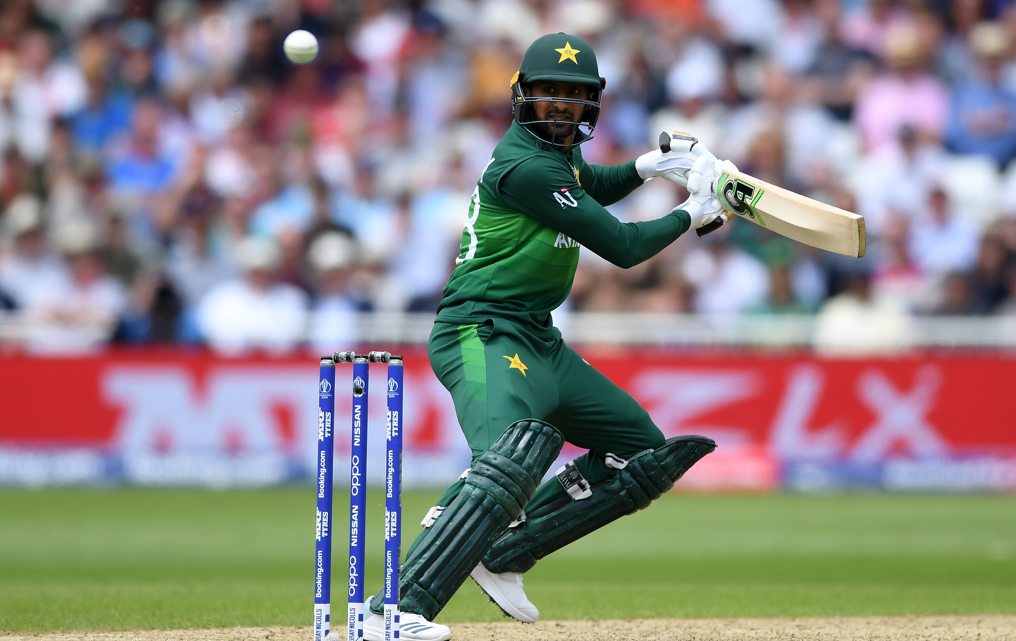 Malik's gritty fifty anchors Pakistan's chase