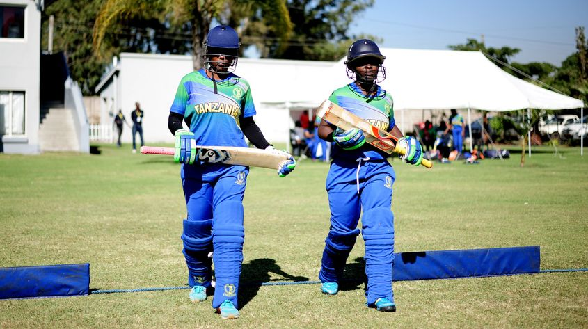 Fatuma Kibasu and Monica Pascal of Tanzania walk out to bat