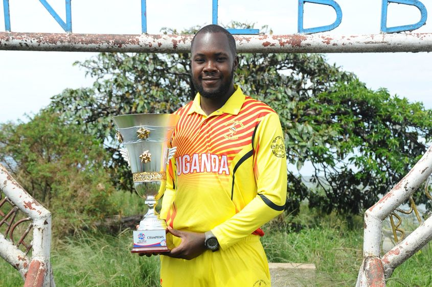 Uganda captain Roger Mukasa with the ICC T20 World Cup Africa Final Qualifier trophy