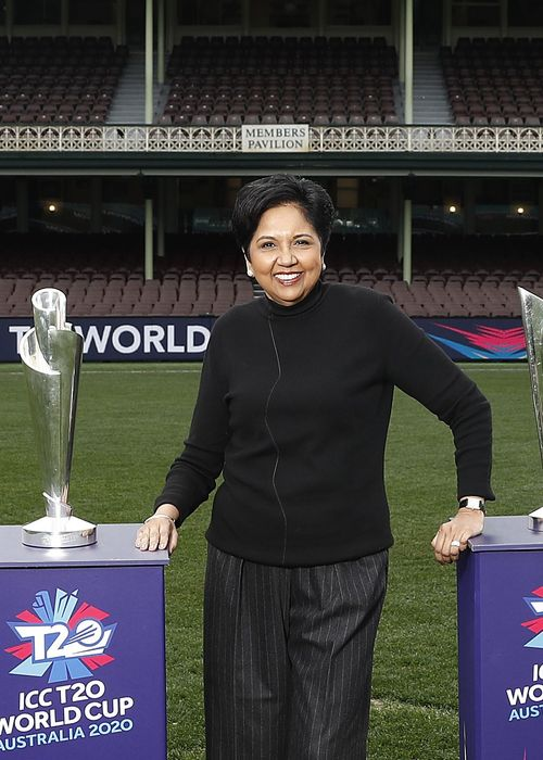 Indra Nooyi poses with the WorldT20 trophies at the SCG