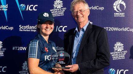 Player of the match, Scotland captain, Kathryn Bryce, receives her trophy from the Chairman of Cricket Scotland, Tony Brian.