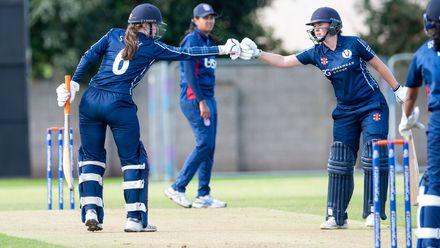 The Bryce sisters touch gloves after a boundary