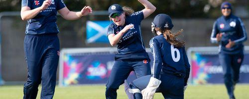 Scotland celebrate the wicket of The USA's Shebani Bhaskar for 0.