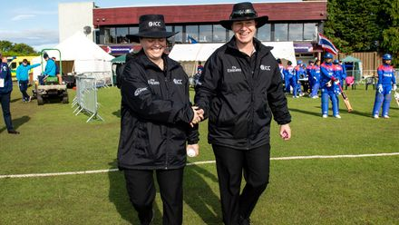 Umpire, Eloise Sheridan, from Australia and Umpire, Claire Polosak, from Australia take the field.