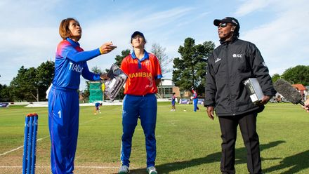Thailand captain, Sornnarin Tippoch flips the coin as Namibia captain, Yasmeen Khan and Umpire, Jacqueline Williams, from Jamaica look on.